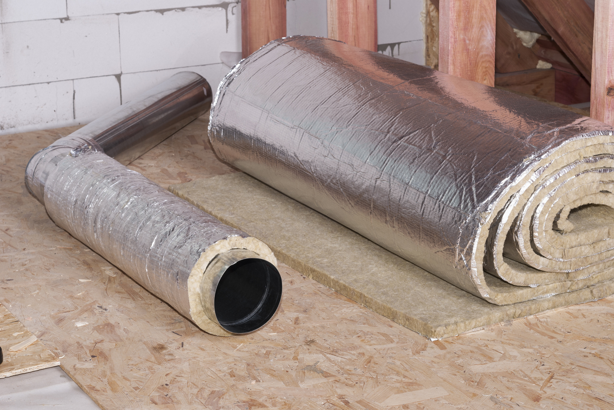 Rolls of Underlay for Laminate Flooring with Silver backing on wooden subloor